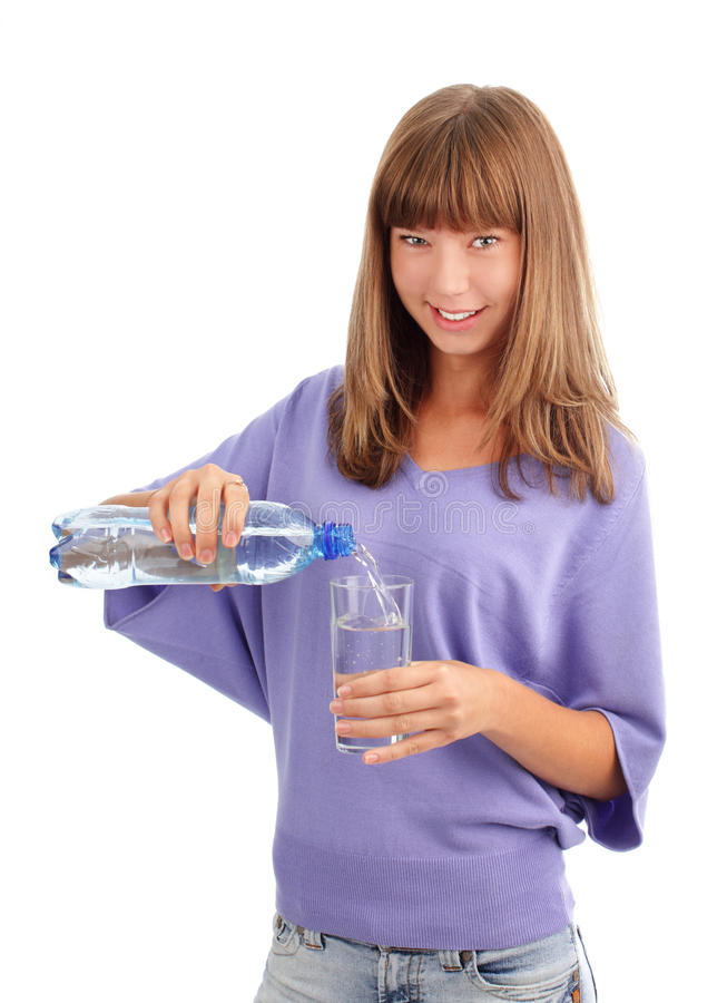 Woman pouring water in a glass stock photos