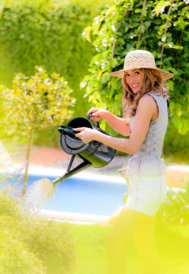 Download Woman pours flowers stock photo. Image of summer, people - 14623122