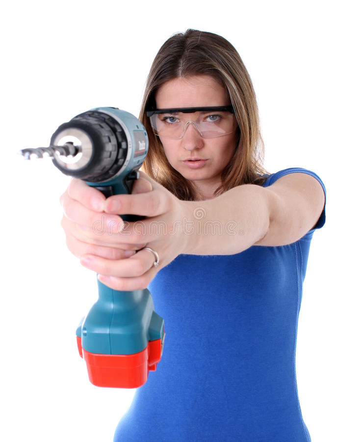 Woman with power drill. Woman holding a cordless power drill royalty free stock images