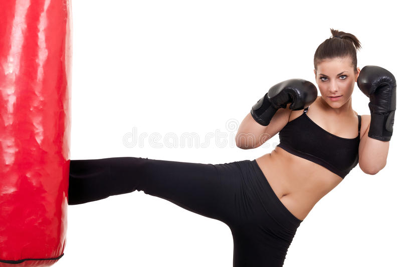 Woman practicing kickbox stock photo