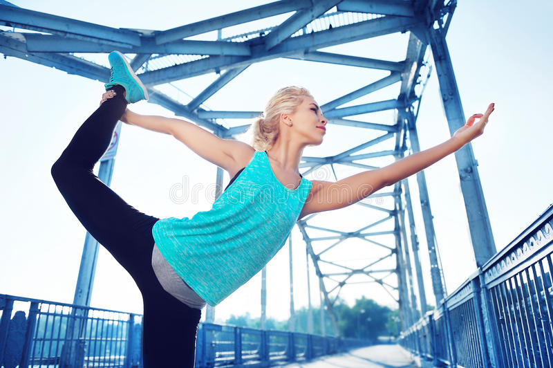 woman practicing king dancer yoga pose royalty free stock image
