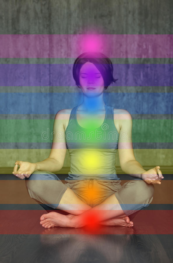 Woman practicing meditation with the chakras. Beautiful young doing yoga in lotus posture the activation of the on. Woman practicing meditation with the chakras stock photography