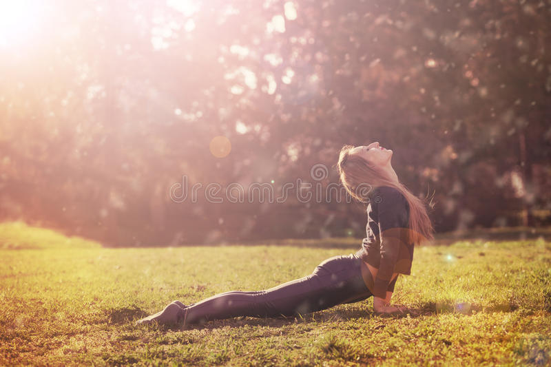 Woman practicing morning meditation in nature royalty free stock photos