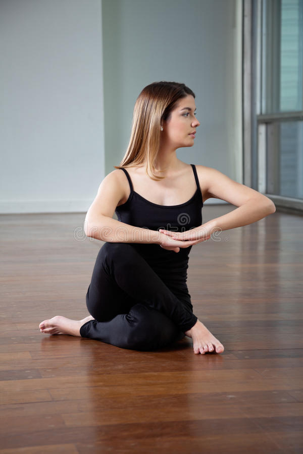 Woman Practicing Yoga Exercise stock image