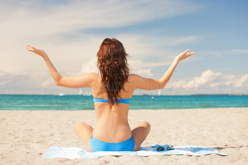 Download Woman Practicing Yoga Lotus Pose On The Beach Stock Photo - Image of balance, beauty: 39515604