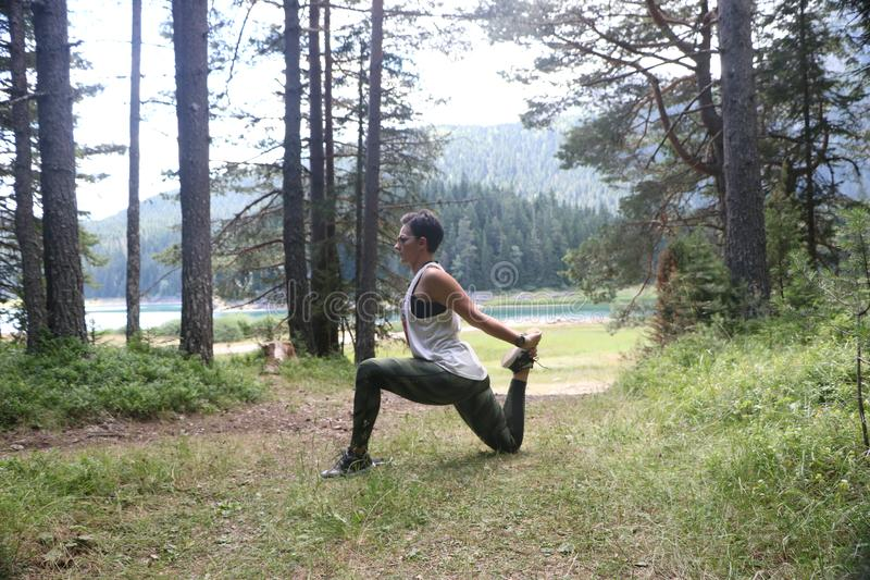Download Woman Practicing Yoga Outdoors Stock Photo - Image of hatha, meditation: 102747526