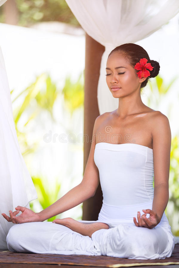 Woman practicing yoga outside royalty free stock images