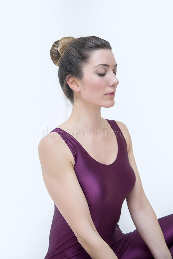 Woman practicing yoga stock photography