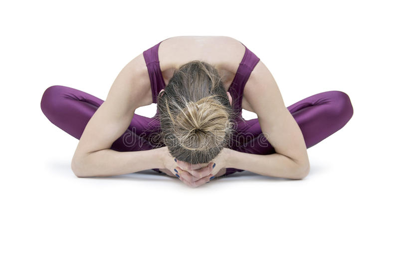 Woman practicing yoga royalty free stock photography