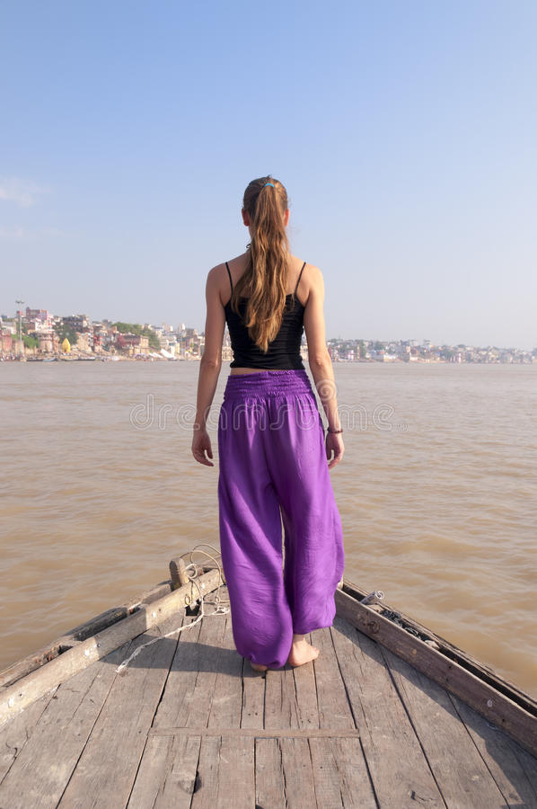 Woman practising standing yoga meditation on the boat stock image