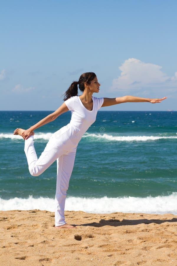 Woman practising yoga stock image