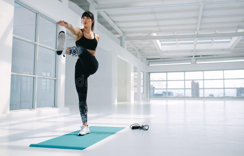 Woman practising yoga asana in fitness studio royalty free stock photos