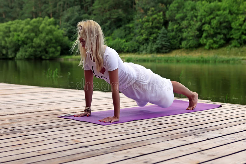 Download Woman Practising Yoga Exercise Stock Image - Image: 26316563