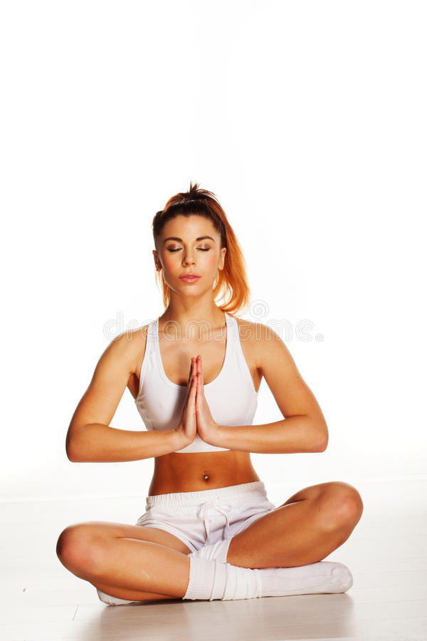 Woman practising yoga royalty free stock photography
