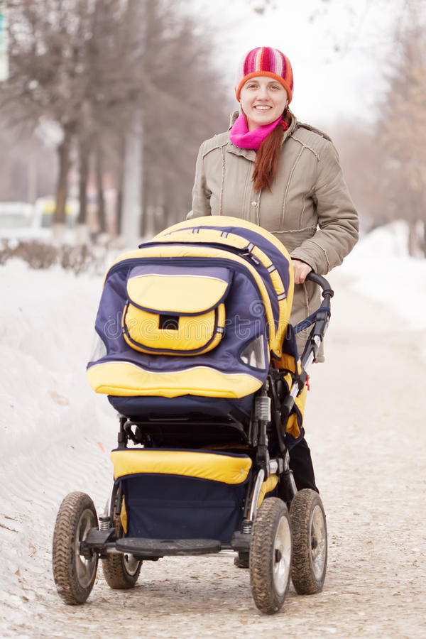 Download Woman with pram in winte stock image. Image of girl, park - 18699361