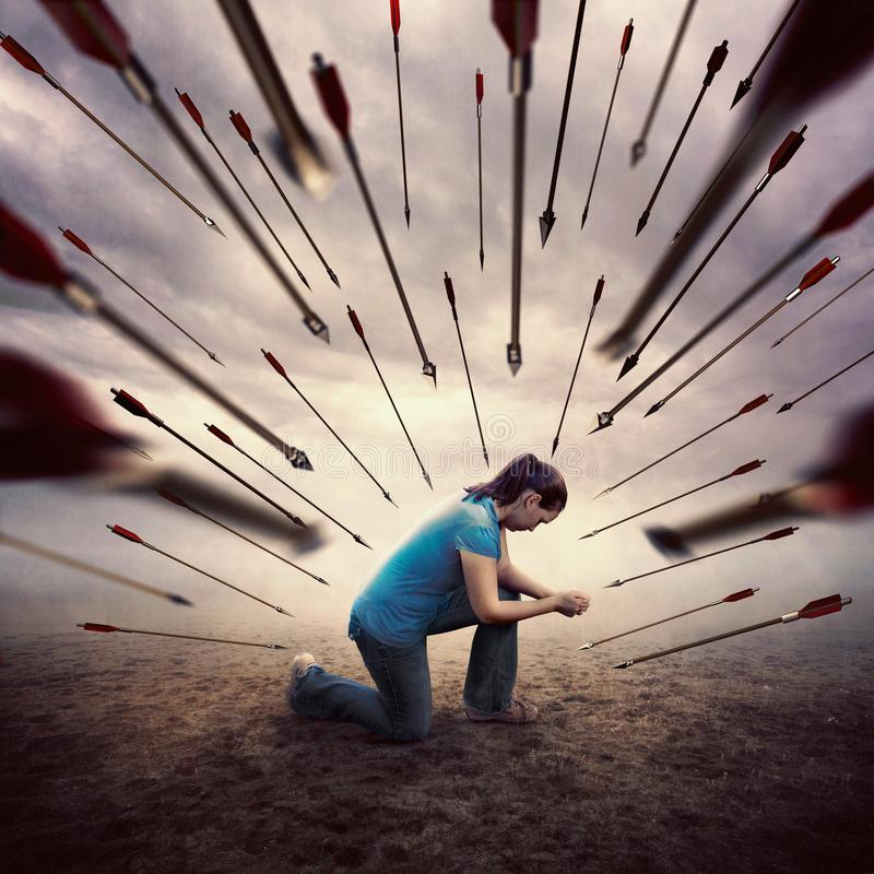 A woman praying during an attack royalty free stock image