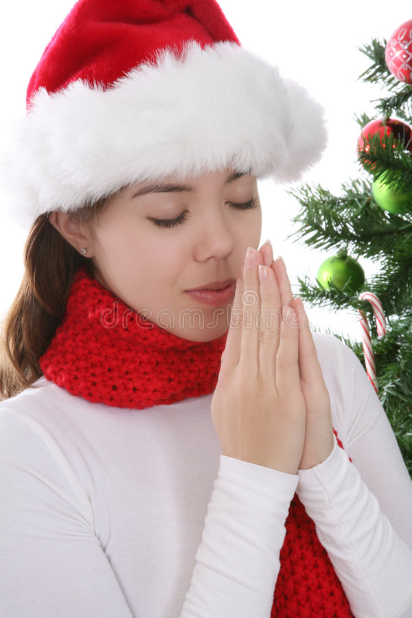 Woman praying at Christmas stock photography
