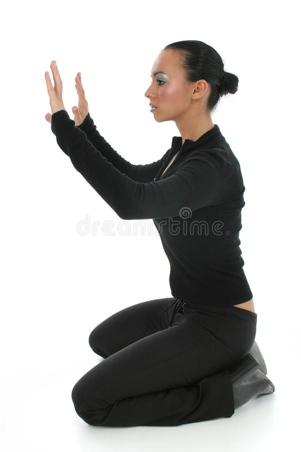 Woman Praying on Floor stock image