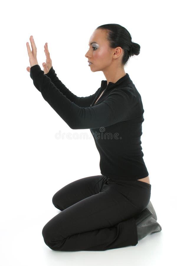 Woman Praying On Floor Stock Image