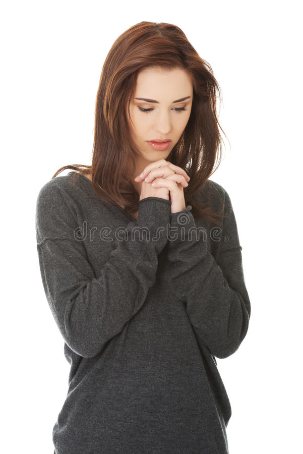 Woman praying with her hands together royalty free stock photos