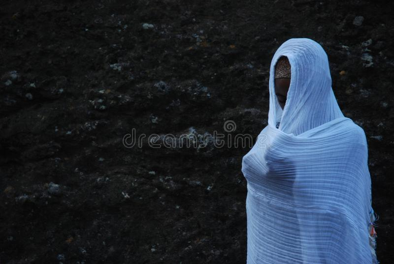Woman praying, Lalibela, Wollo, Ethiopia royalty free stock images