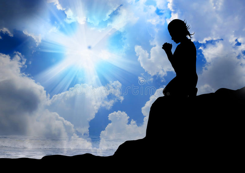 Woman praying to god stock images