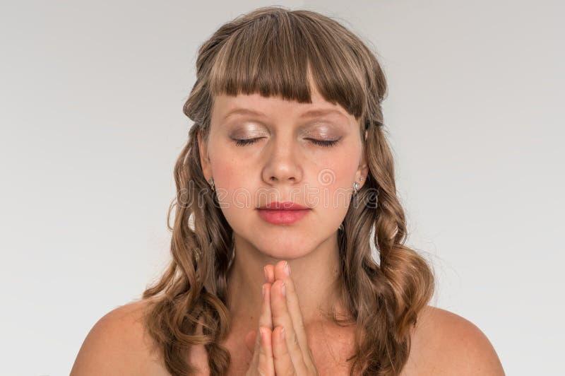 Woman praying to god - spirituality concept. Young woman praying to god - spirituality concept stock image