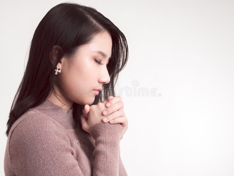 Woman praying to god. On white background royalty free stock photos