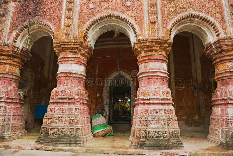 Woman prays at the Pancharatna Govinda Hindu temple in Puthia, Bangladesh. stock images