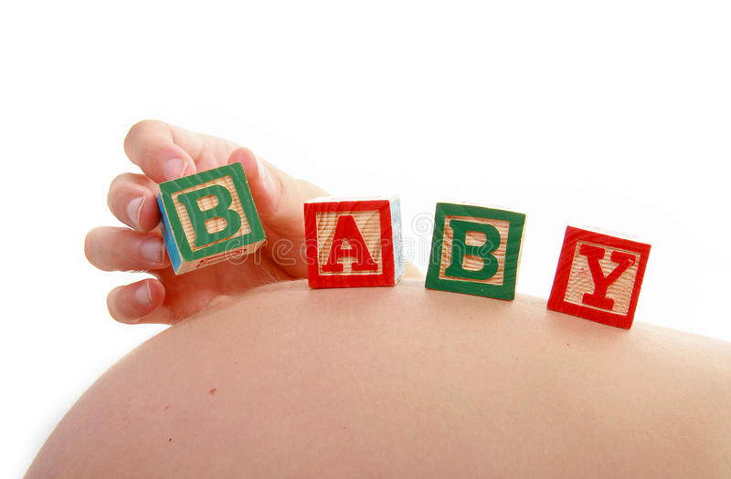 Woman pregnant and baby cube royalty free stock images