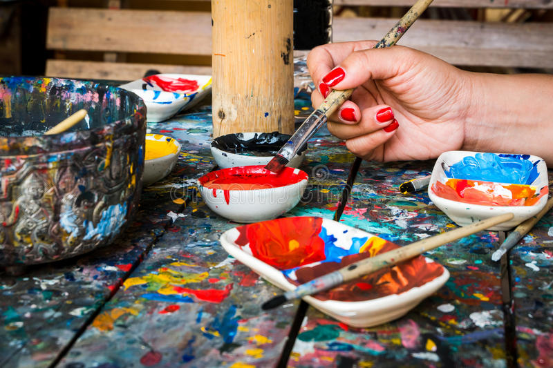 Woman prepare to paint with her painbrush. royalty free stock photo
