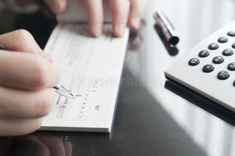 Woman prepare writing a check royalty free stock photography