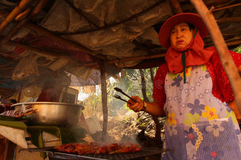 Download A Woman Prepares Food Street Editorial Stock Photo - Image: 23566773