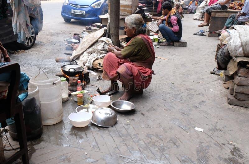Woman preparing food on street, Kolkata royalty free stock photos