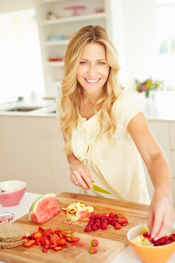 Woman Preparing Healthy Breakfast In Kitchen royalty free stock images