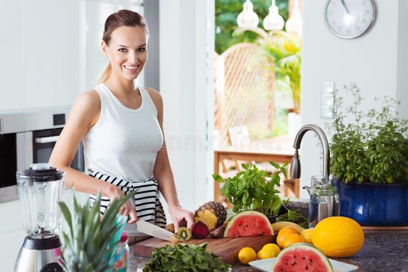 Woman preparing healthy fruit salad stock photo