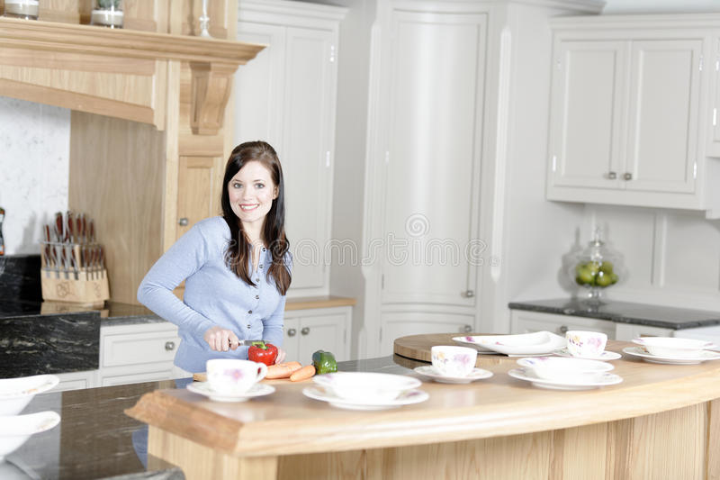Download Woman Preparing A Meal In The Kitchen Stock Photo - Image: 33522434