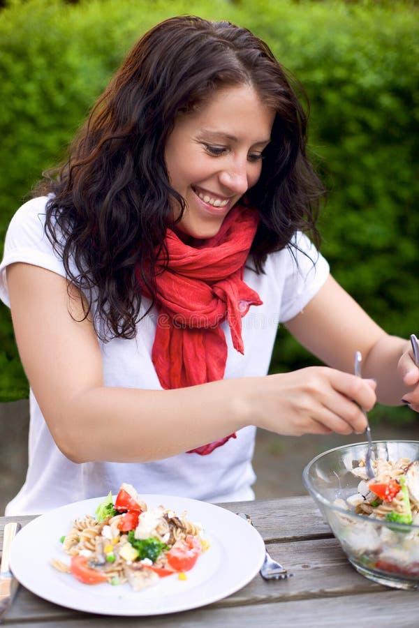 Woman Preparing a Pasta Dish