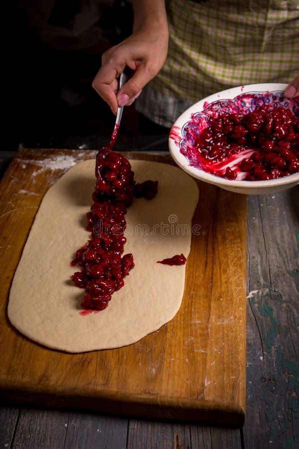 A woman is preparing a pie stock photo