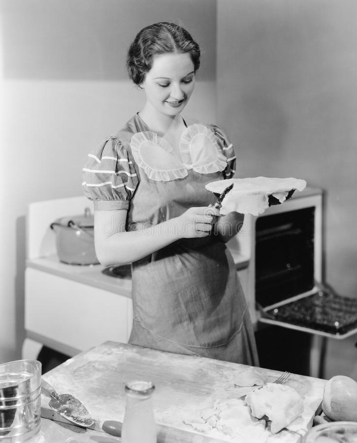 Woman preparing a pie in the kitchen stock image