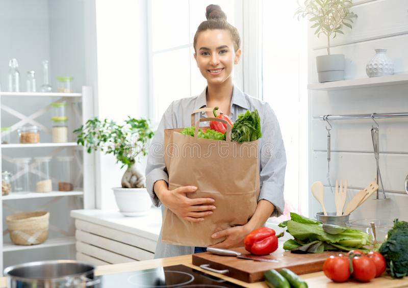 Woman is preparing proper meal. Healthy food at home. Happy woman is preparing the proper meal in the kitchen royalty free stock images