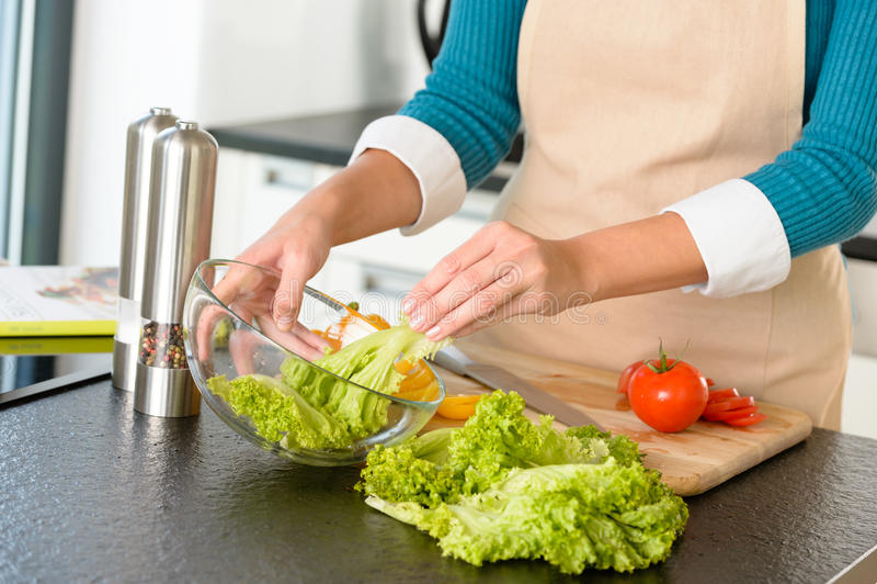 Woman preparing salad vegetables kitchen cooking food stock image