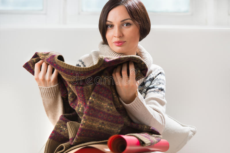 Woman preparing surprise for her husband or boyfriend. Portrait of a woman preparing to her husband or boyfriend surprise with a gift on his birthday or stock photos