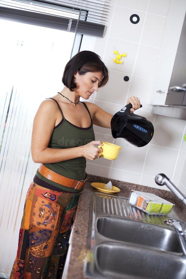 Download Woman preparing the tea stock image. Image of home, preparing - 19501579