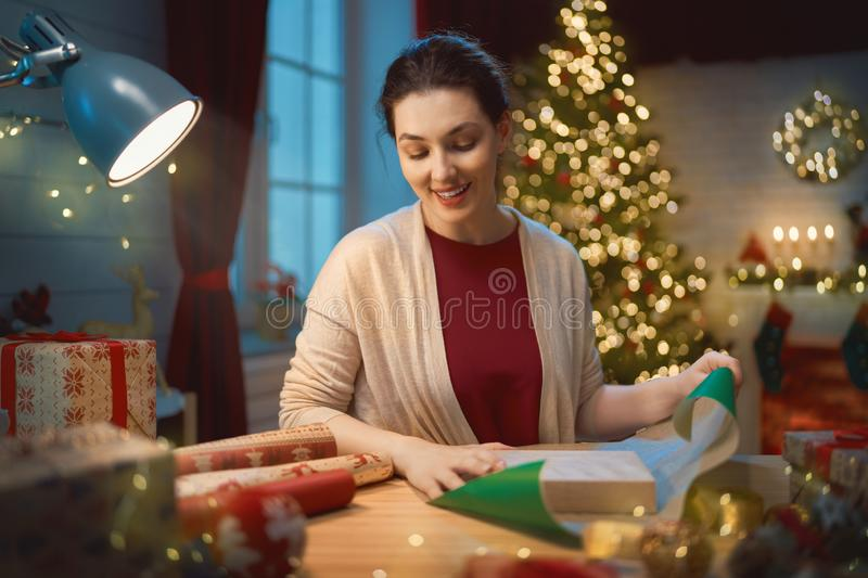 Woman preparing Xmas gifts royalty free stock photo
