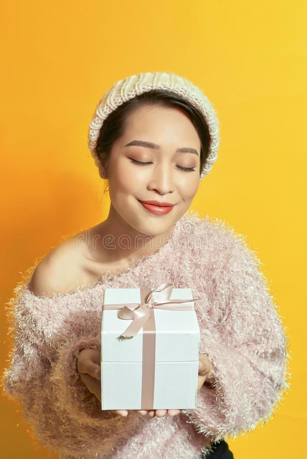 Woman with a present. Happy girl with a gift royalty free stock image