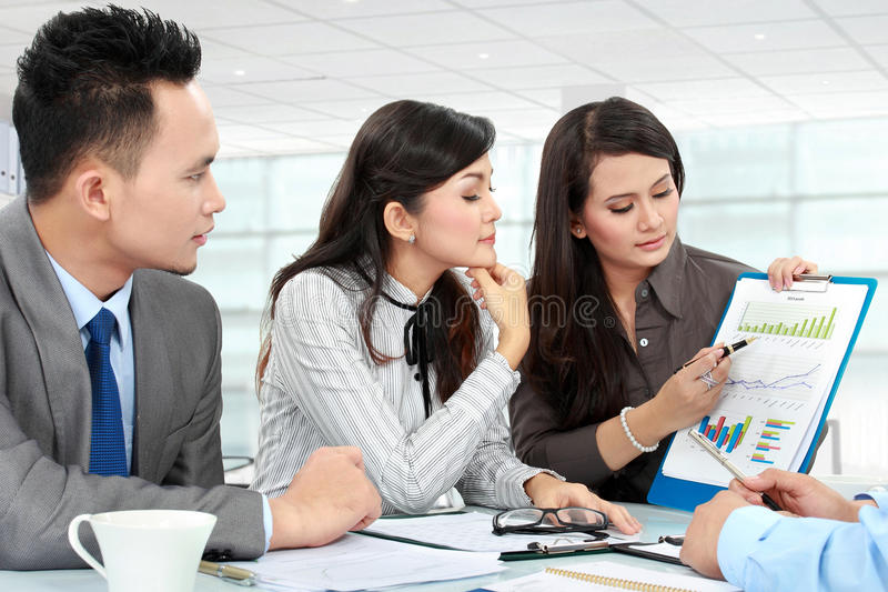 Woman presenting business report royalty free stock photography