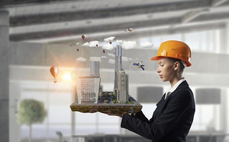 Woman presenting construction model stock photos