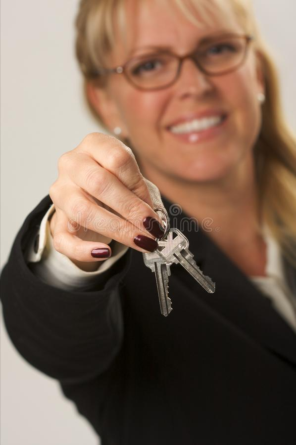 Woman Presenting Keys royalty free stock photos