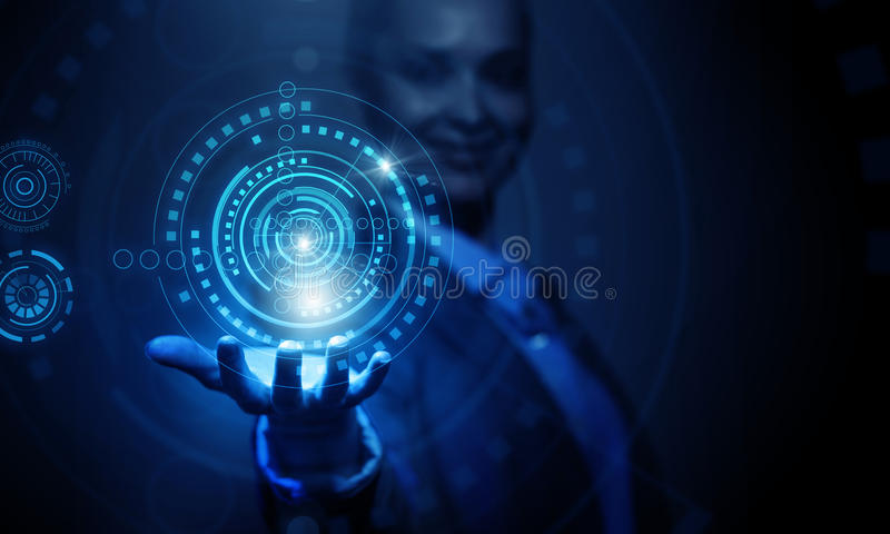 Woman presenting modern technologies royalty free stock photo